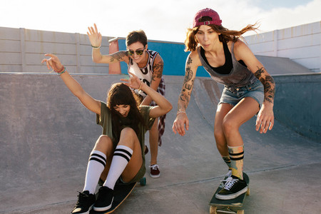 Group of women riding skateboards at skate park