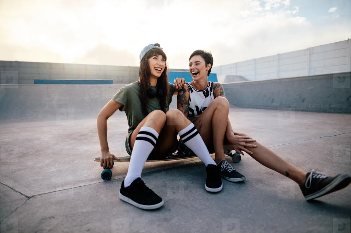 Urban girls enjoying in skate park
