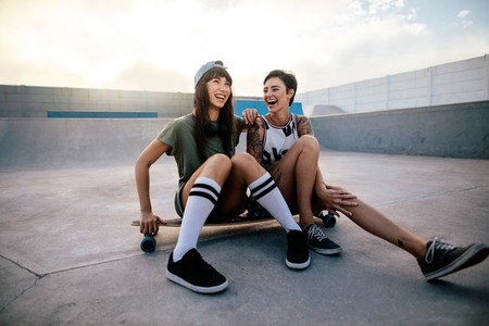 Urban girls enjoying in skate park