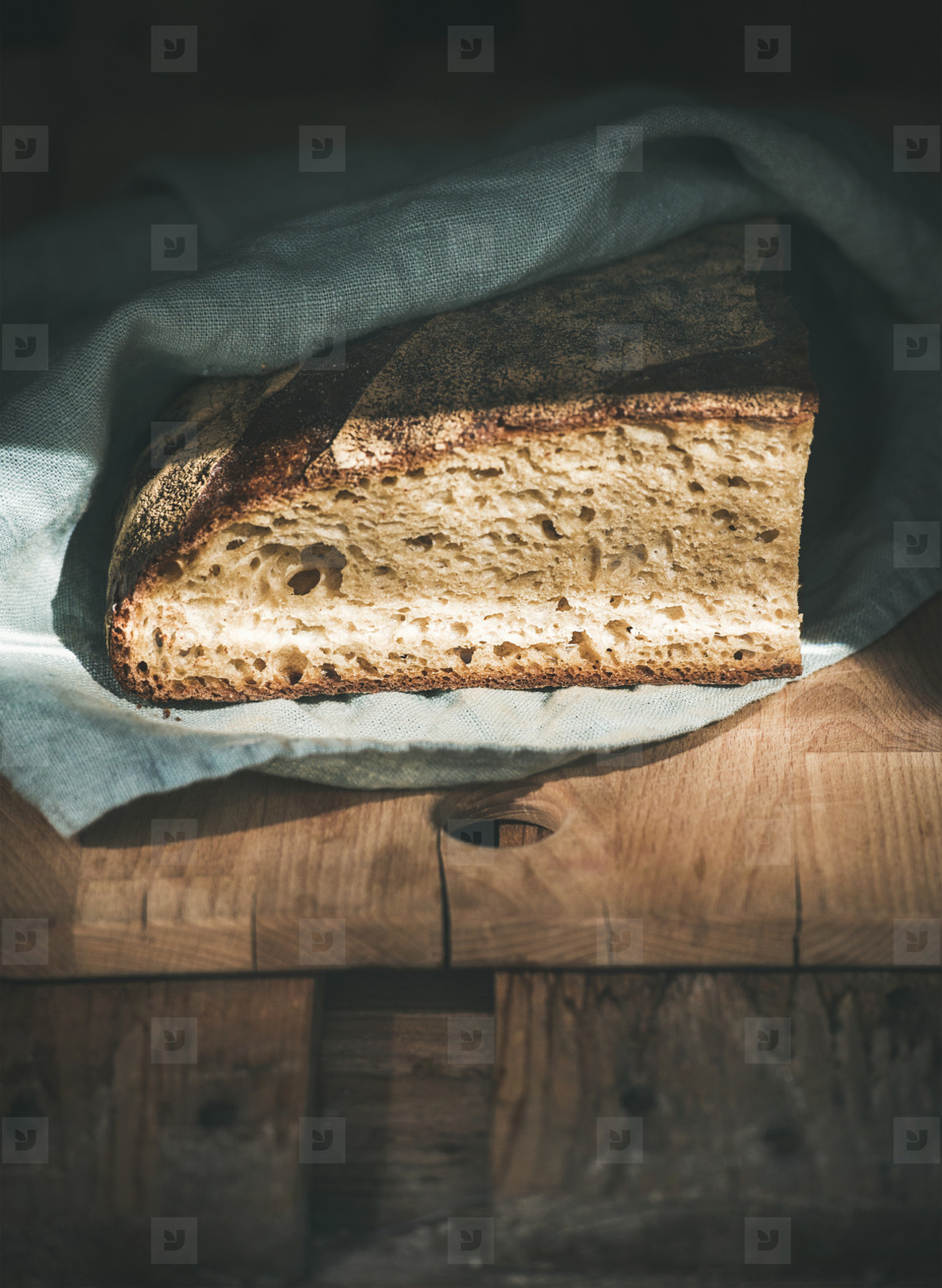 Rustic French rye bread loaf on wooden board  copy space