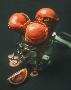 Refreshing summer blood orange ice cream in waffle cones