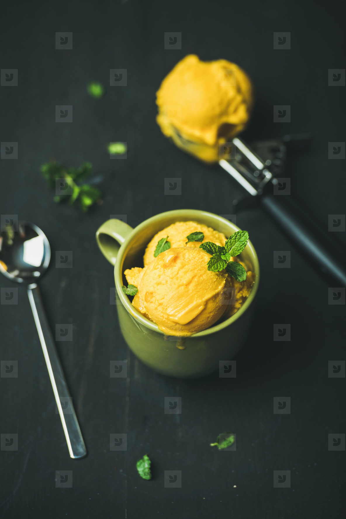 Refreshing Mango sorbet ice cream scoops with fresh mint