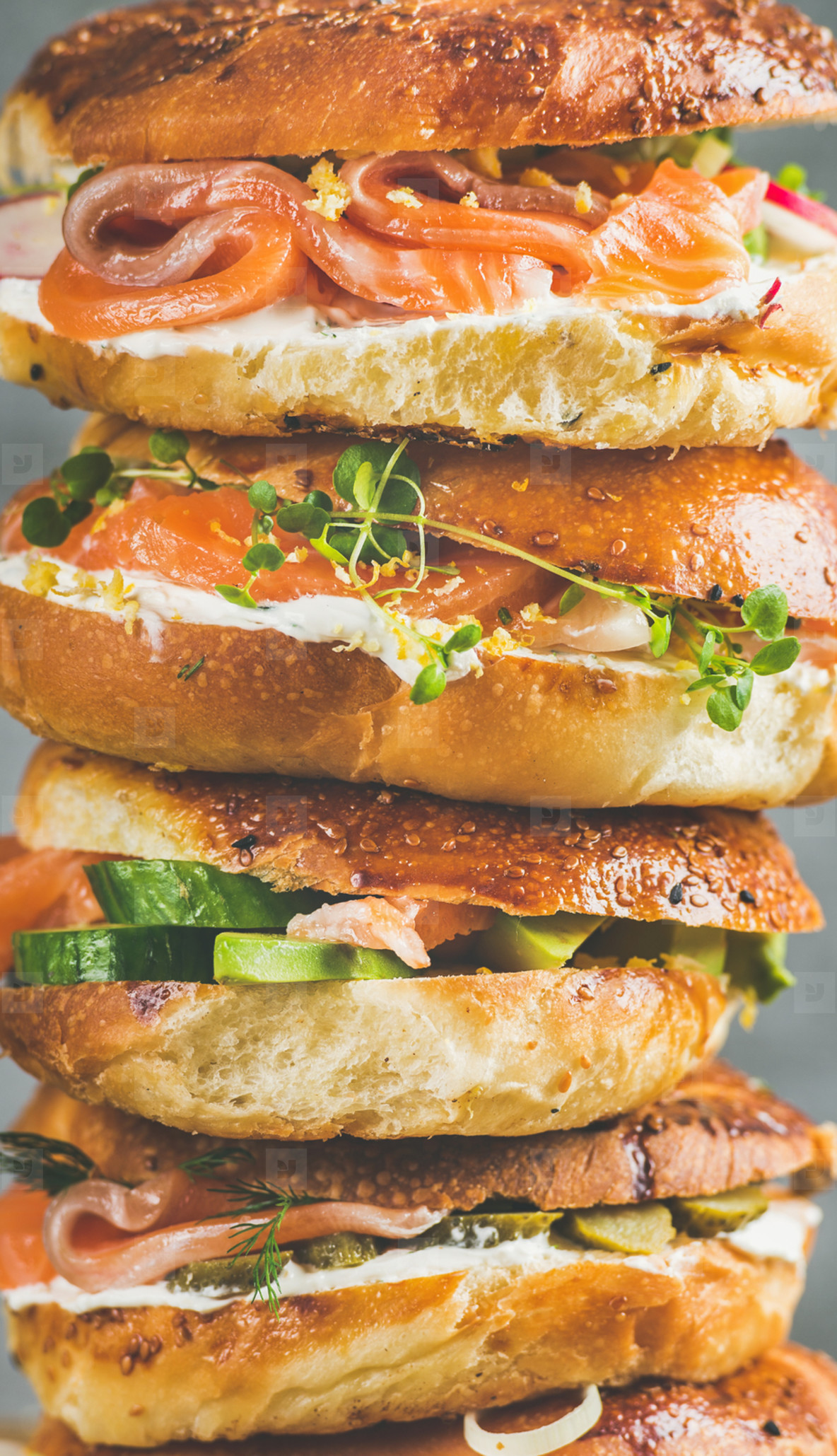 Close up of Bagels with salmon  eggs  vegetables  capers  cream cheese  herbs