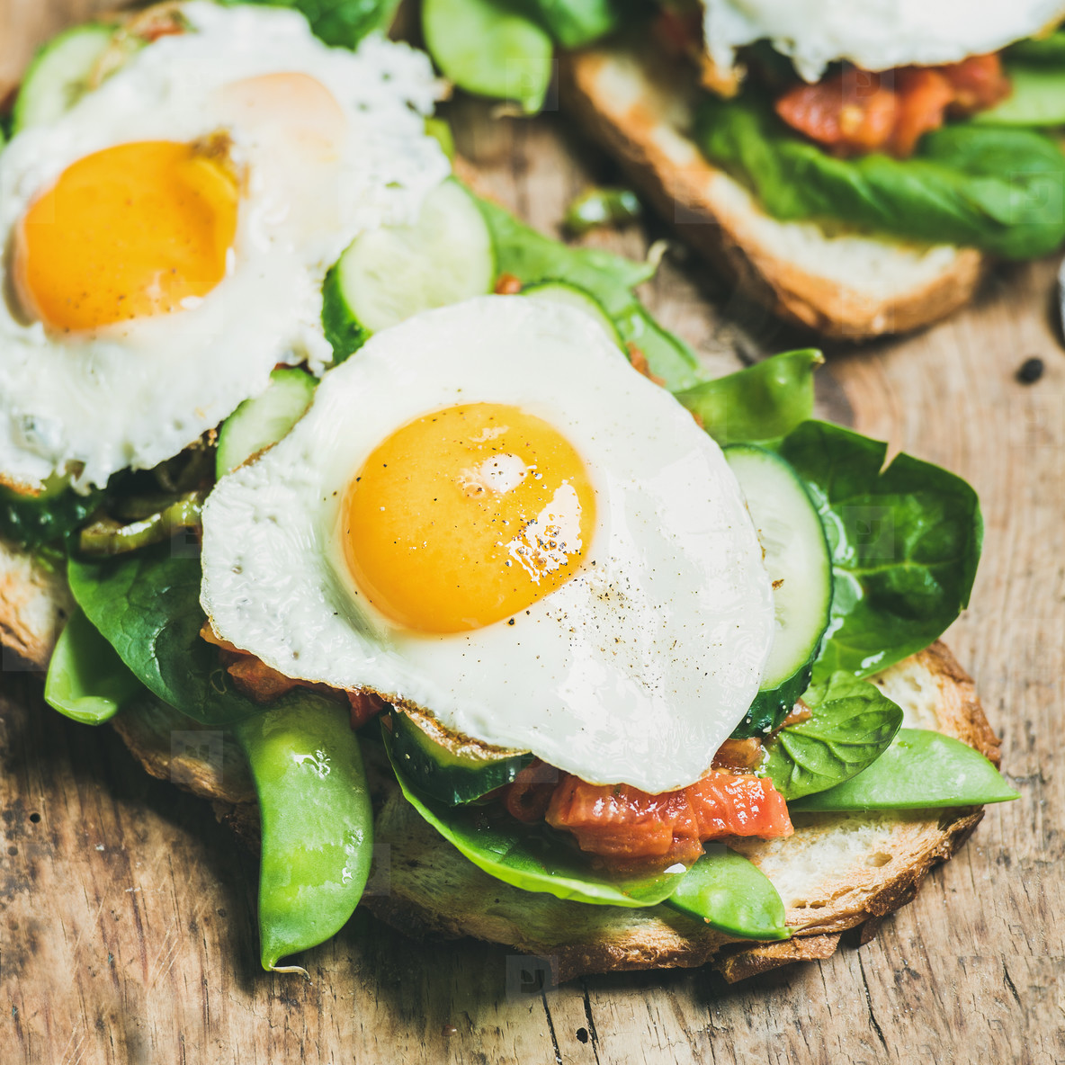 Healthy breakfast sandwiches on wooden board background  square crop