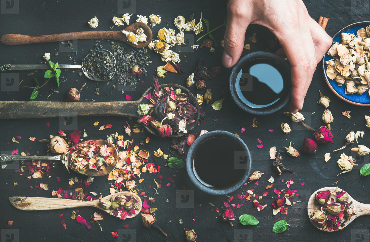 Chinese black tea in stoneware cups in mans hand