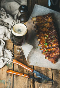 Roasted pork ribs with garlic  rosemary and glass of beer