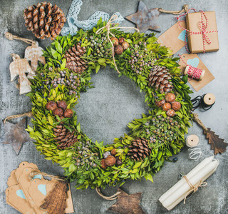 Christmas wreath  pine cones  wooden toys and decoration materials