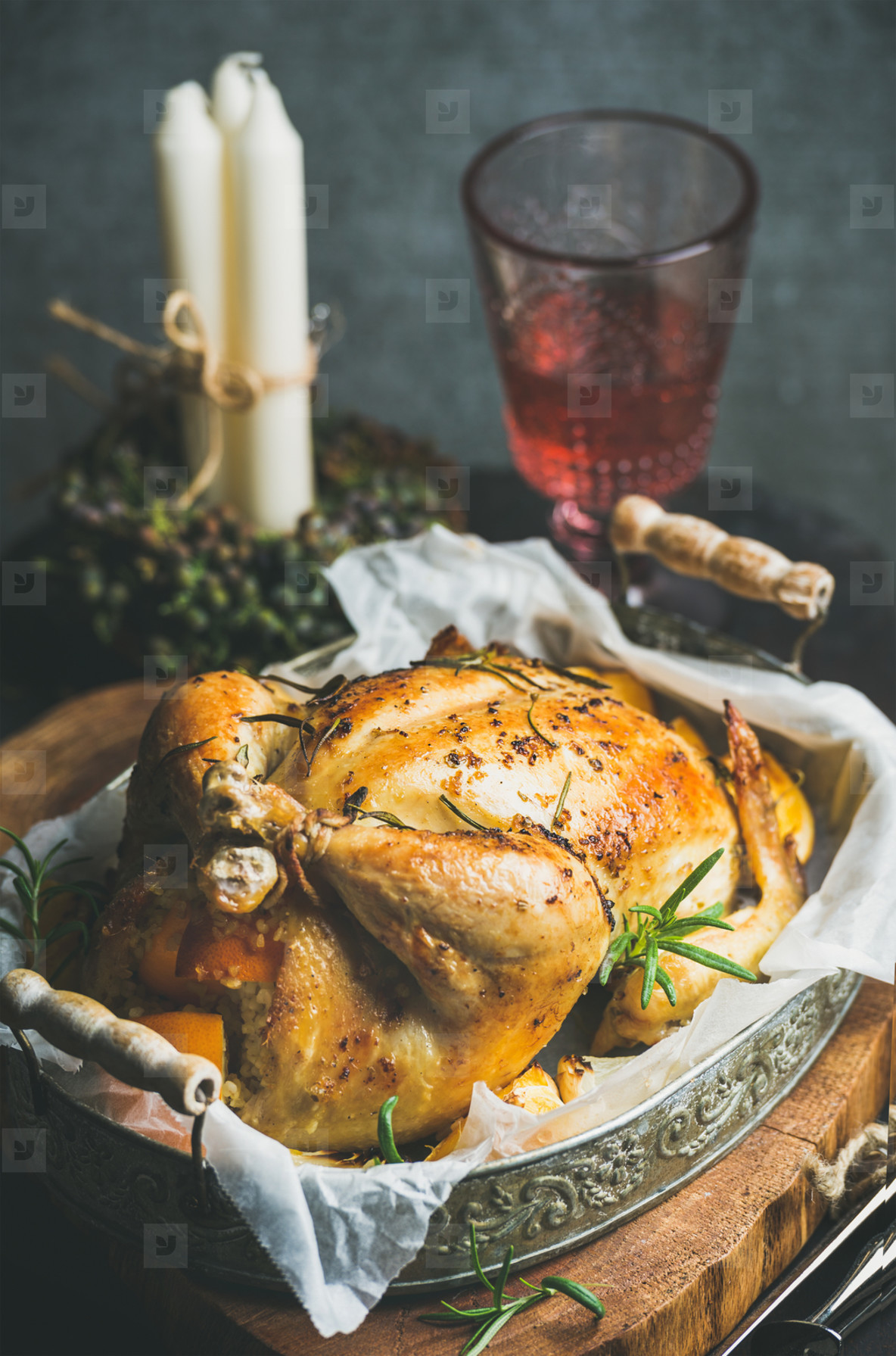 Christmas holiday table set with oven roasted whole chicken