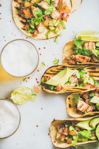Healthy corn tortillas with chicken  vegetables  beer on grey background