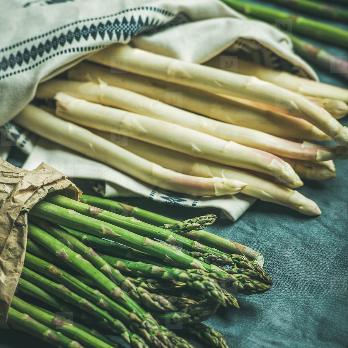 Fresh green and white asparagus in towel  square crop