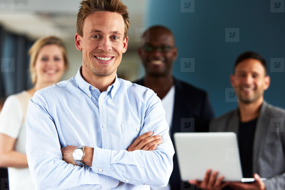 White male executive with arms crossed facing camera