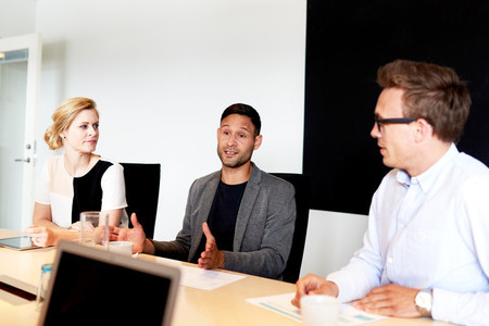 Group of young executives sitting in conference room