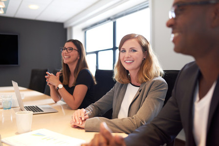 Young white female executive smiling at camera