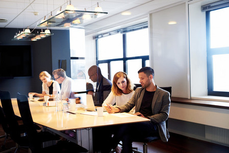 Group of executives working in conference room