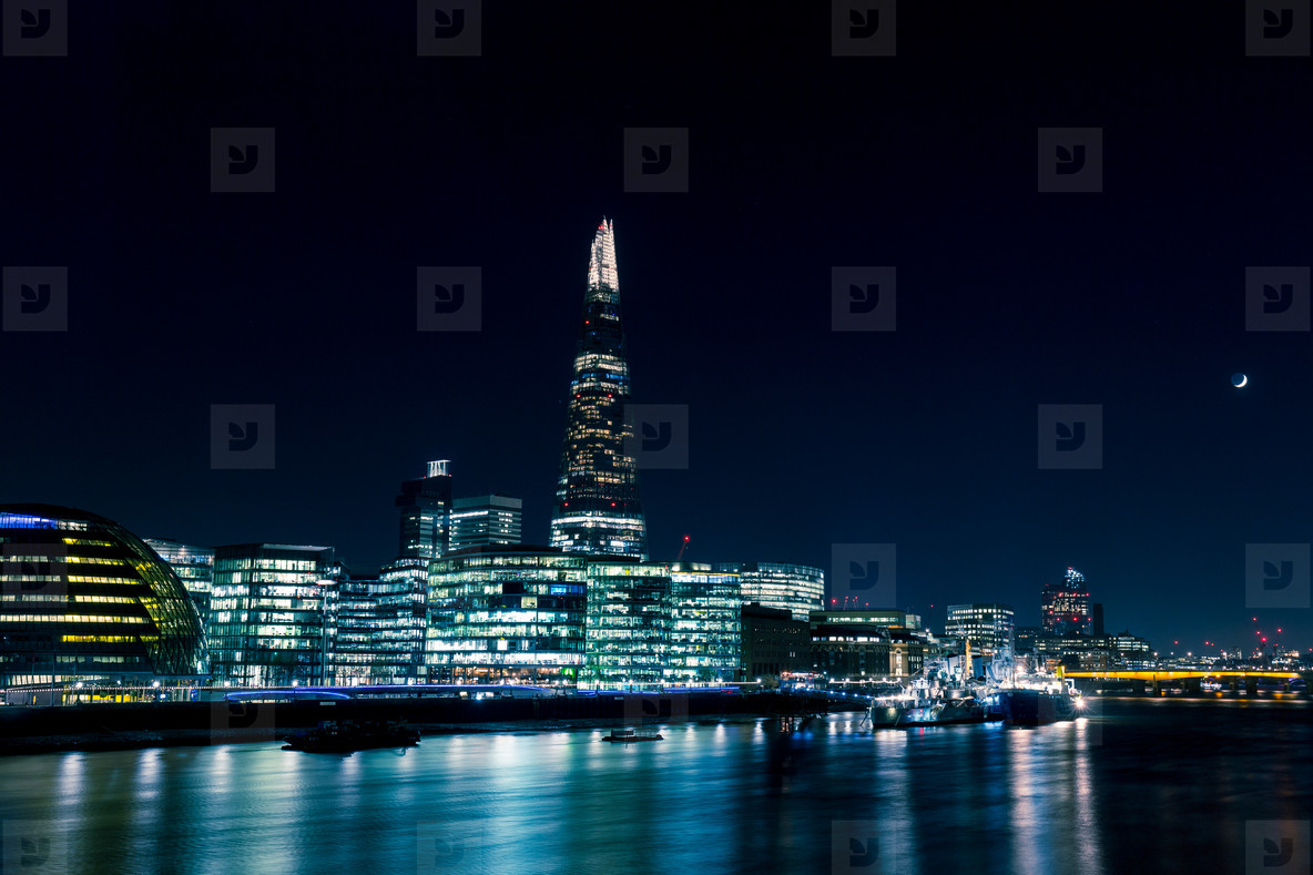 Modern London skyline at night on River Thames