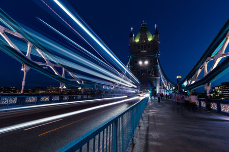 Traffic light trails on Tower Bridge in London at night