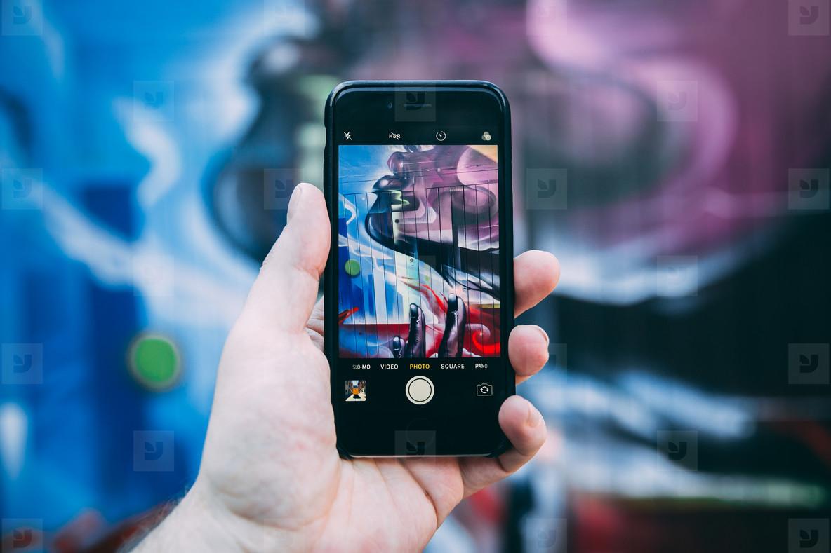 Taking photo of street art