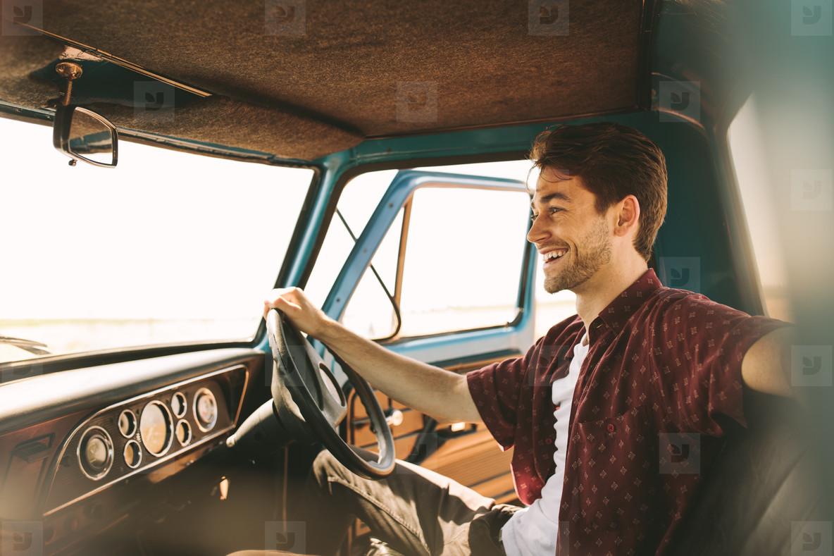 Man on vacation driving his car