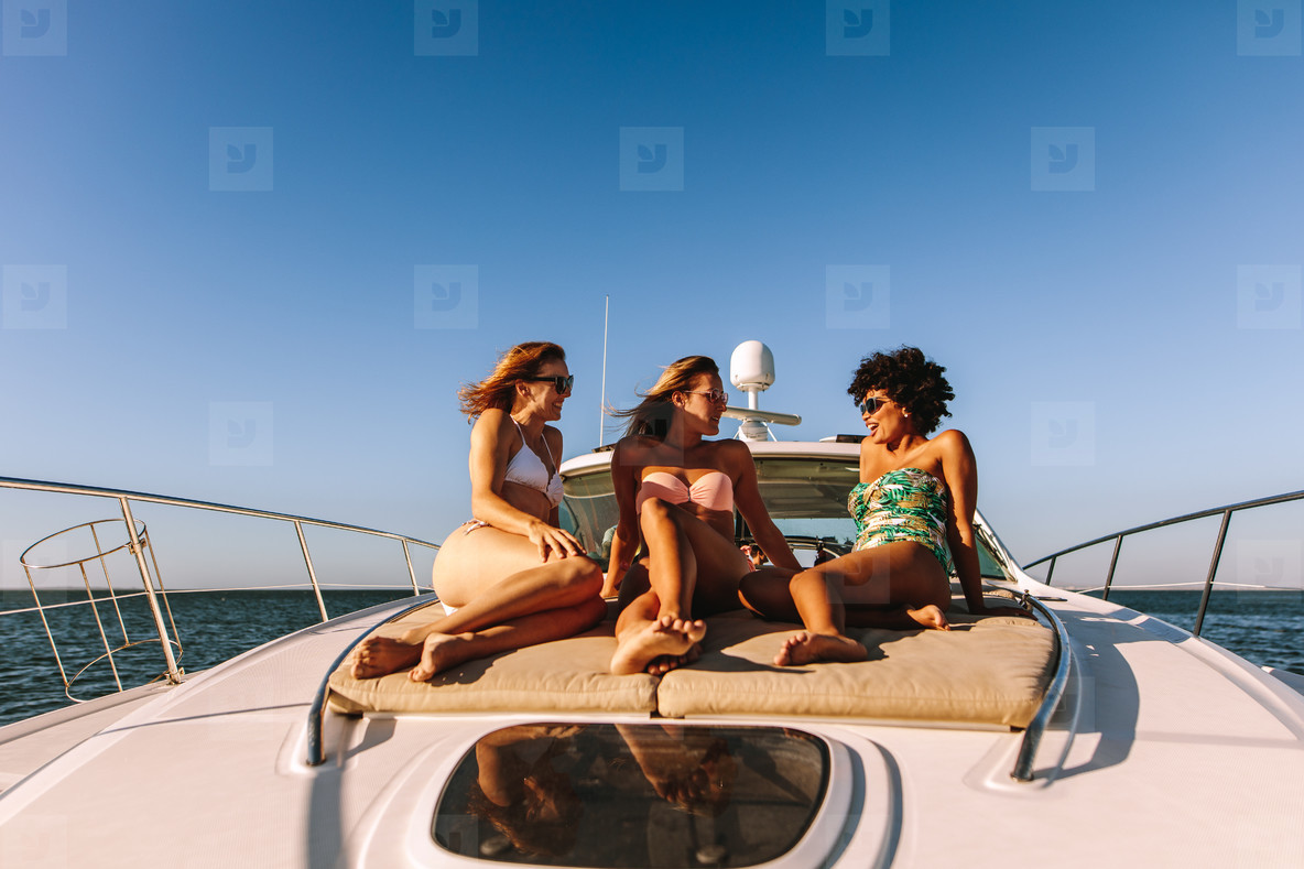 Women on the yacht deck sailing the sea