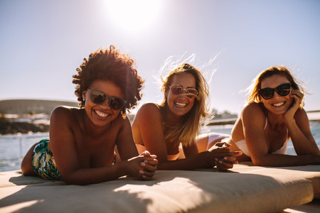 Female friends having a great time on yacht deck