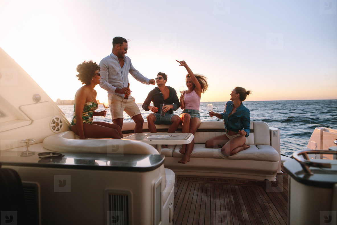 Group of friends enjoying in a boat party