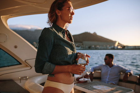 Woman at private boat party with friends