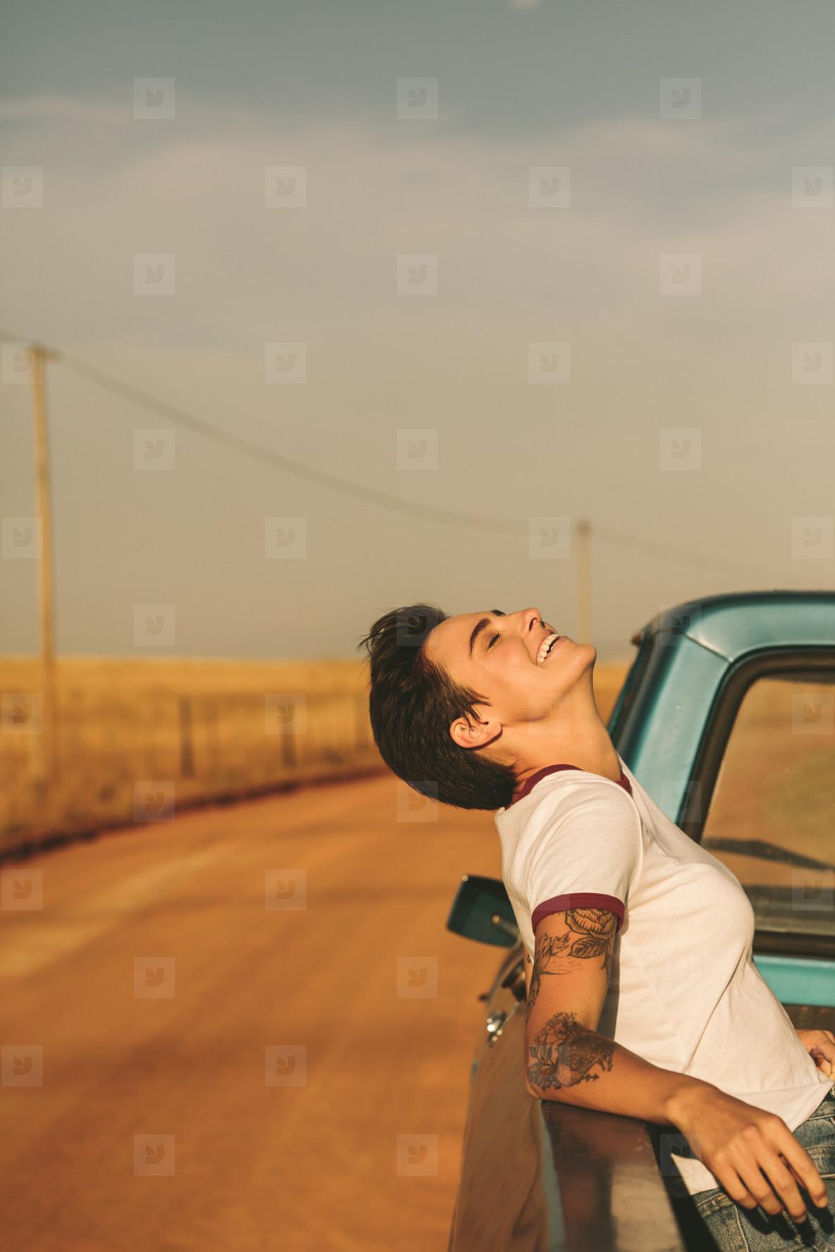 Woman enjoying on a road trip in her car