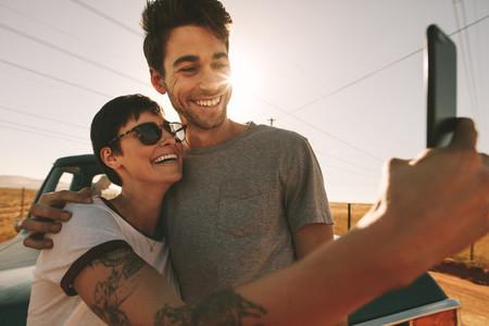 Couple on a road trip taking selfie