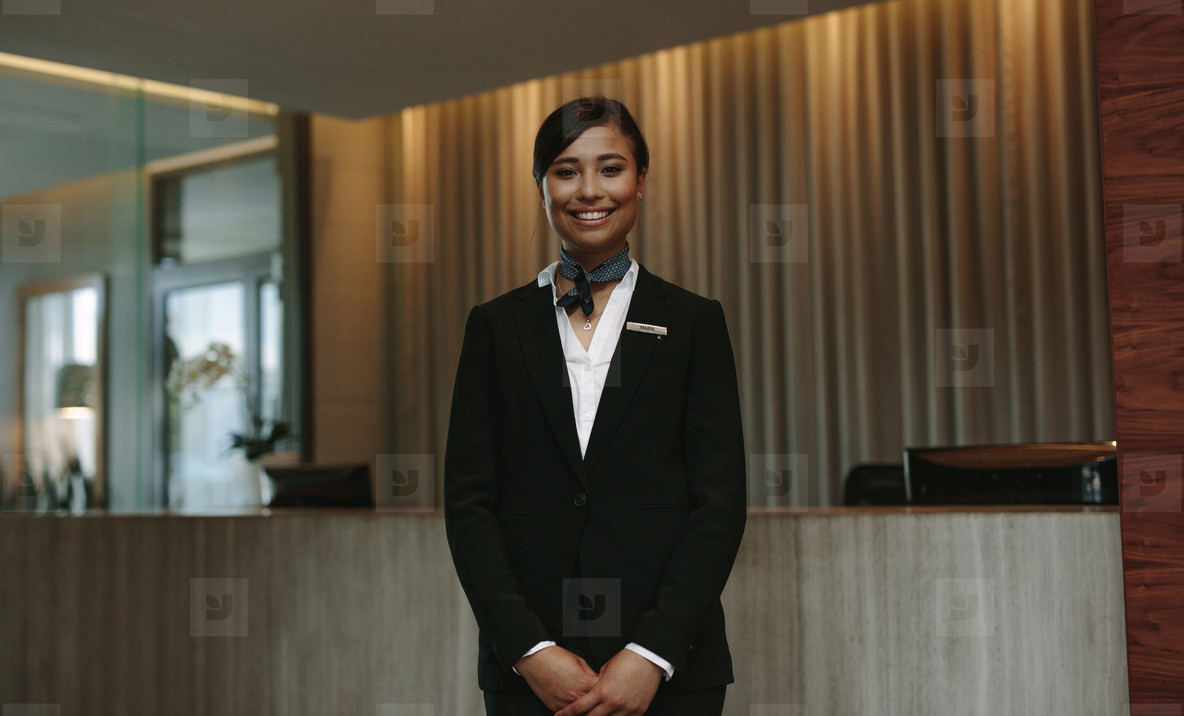 Female hotel receptionist ready to greet guest