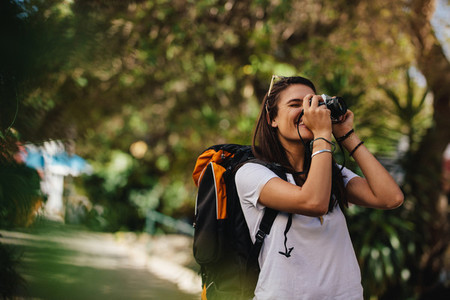 Woman on vacation taking photographs