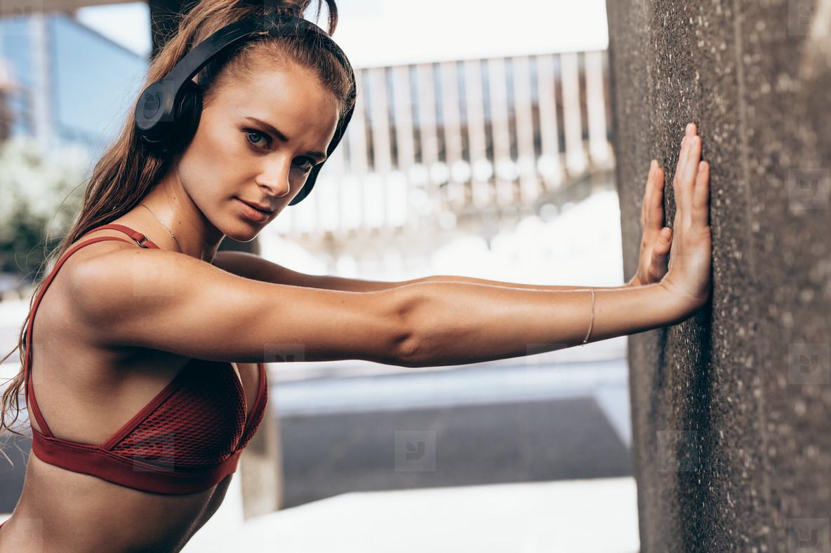 Sportswoman doing warmup exercises