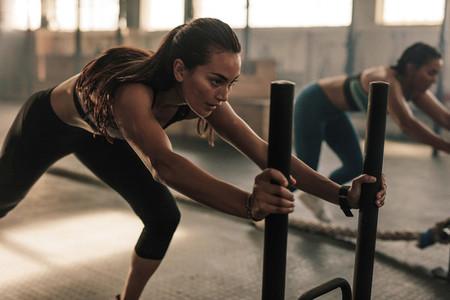 Fit women exercising at gym