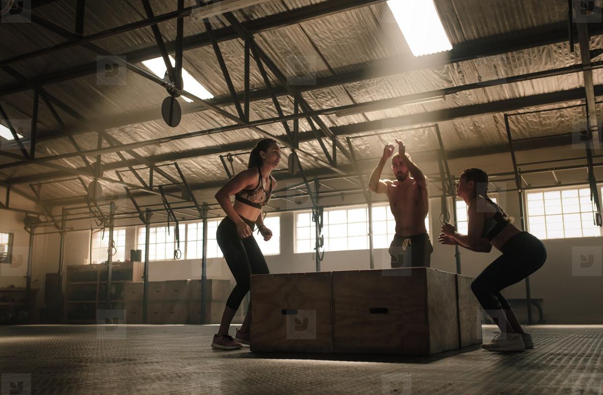 People box jumping at gym
