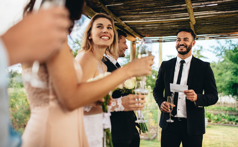 Best man performing speech for toast at wedding reception