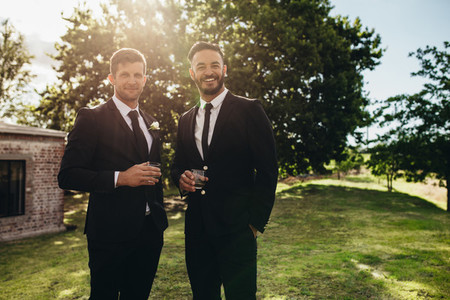 Groom and his friend at wedding party