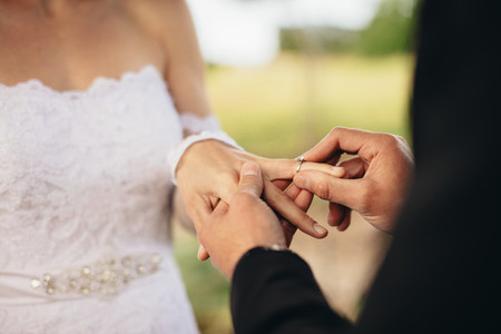 Couple exchanging wedding rings at ceremony