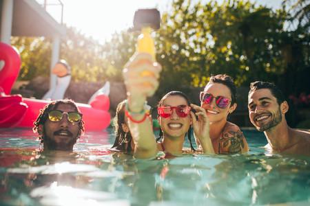 Friends taking selfie in the swimming pool