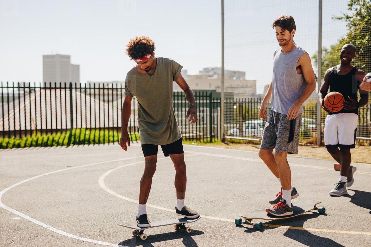Basketball players skating on skateboard