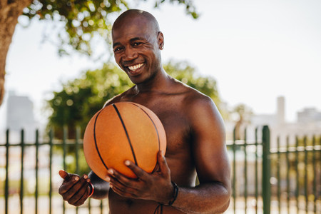 Portrait of man holding a basketball