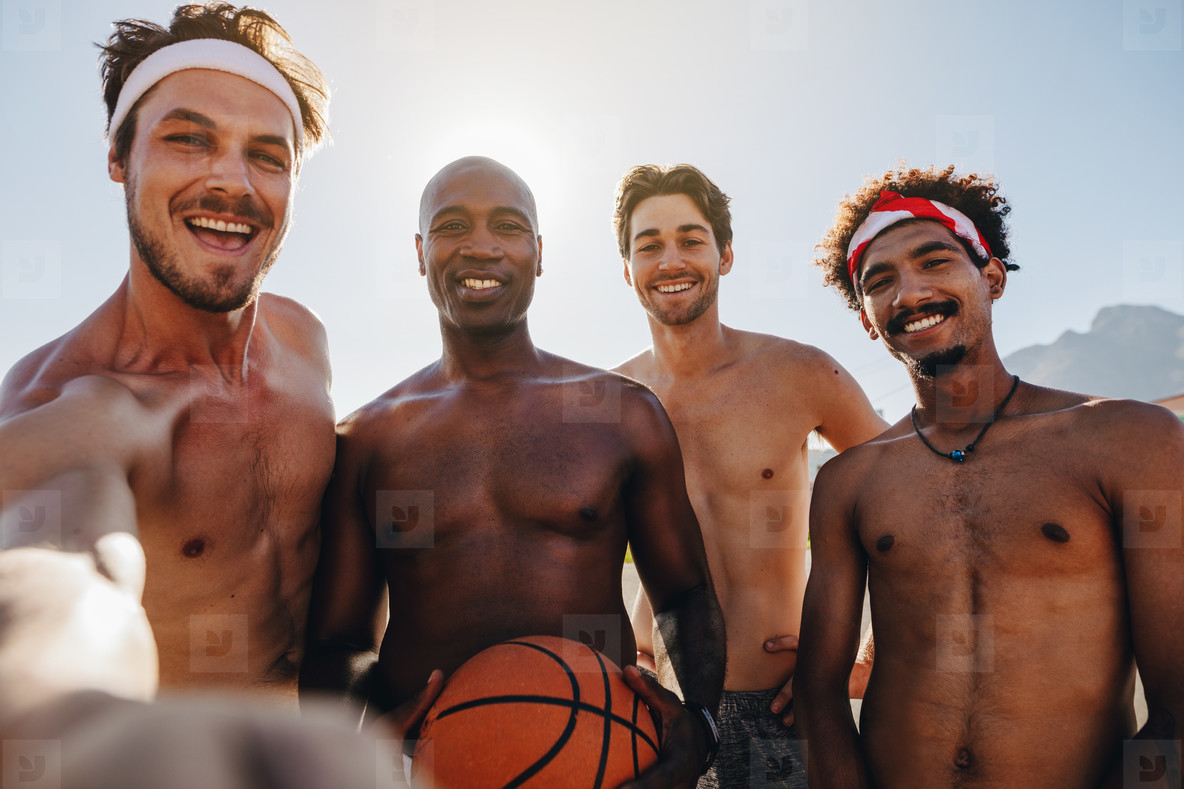 Basketball players posing for photo