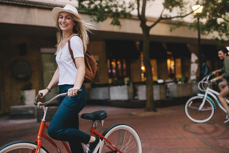 Beautiful woman riding bicycle in the city
