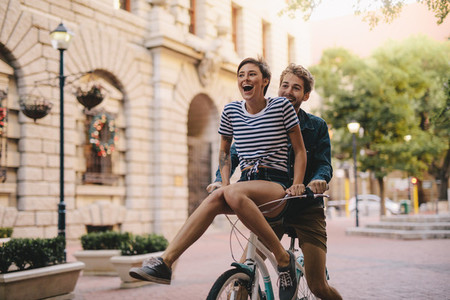 Couple enjoying a bicycle ride in the city