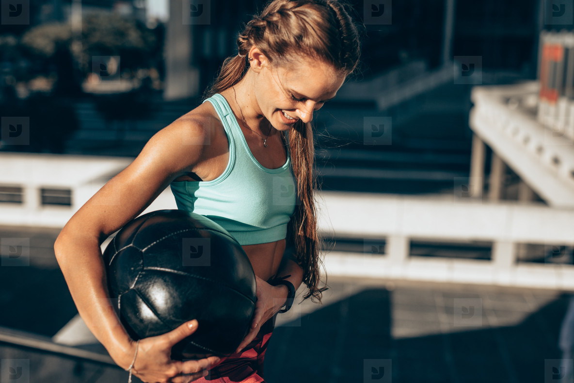 Sportswoman exercising with fitness ball
