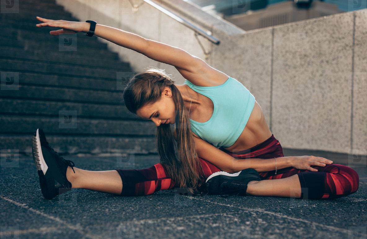 Woman doing stretching exercises in morning