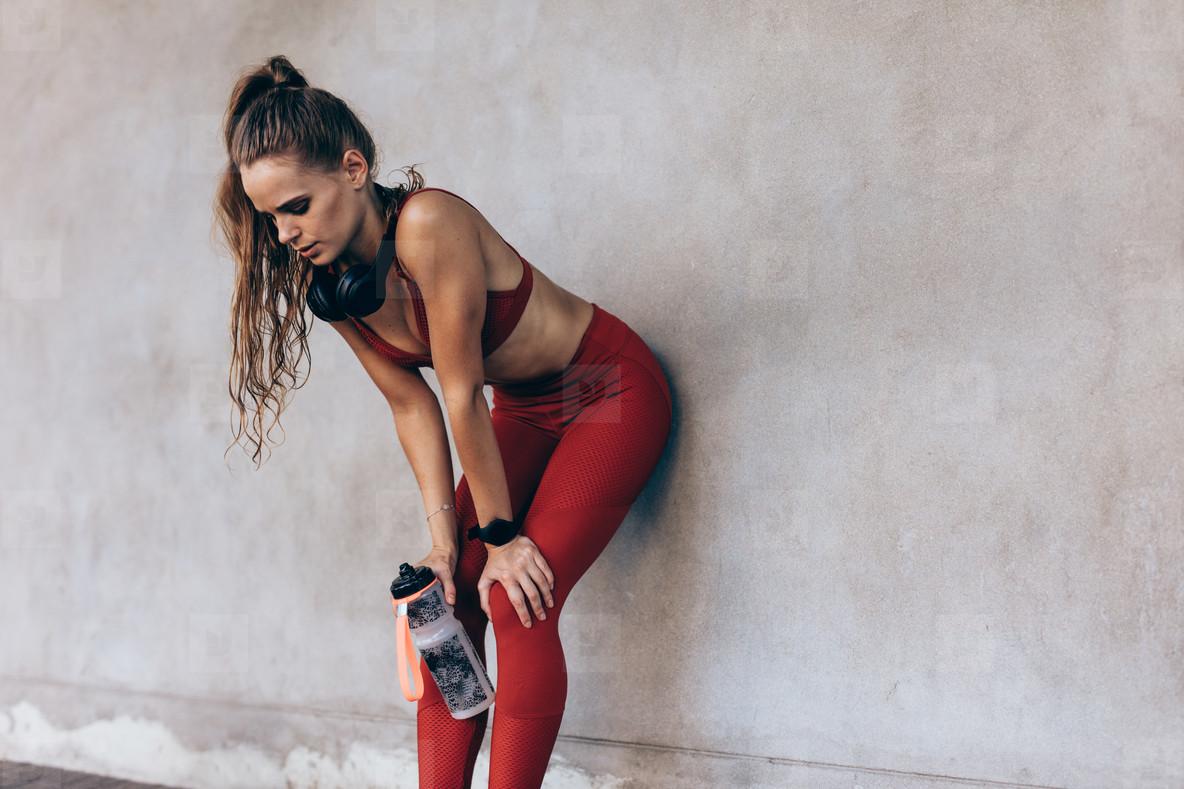 Sportswoman taking a breather