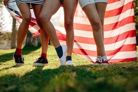 Girls at park with American flag