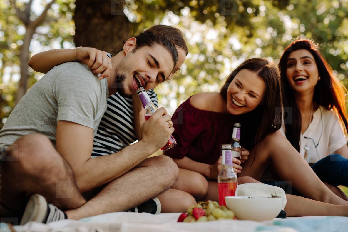 Friends enjoying drinks at picnic