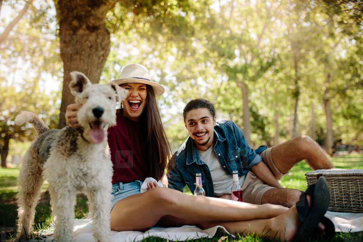 Couple on picnic with pet dog