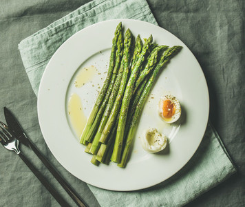 Cooked asparagus with soft boiled egg and herbs