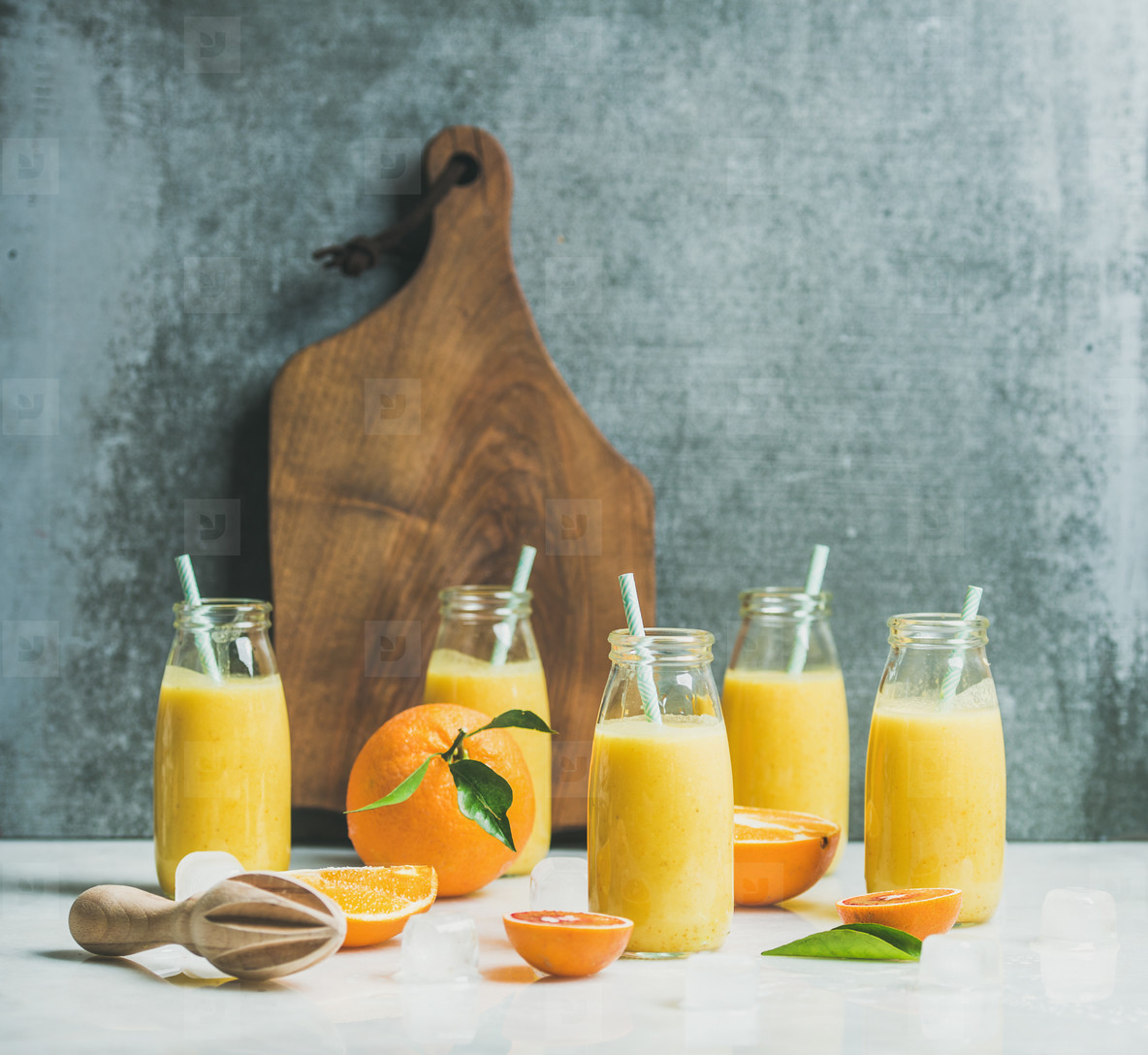 Healthy yellow smoothie with citrus fruit  copy space